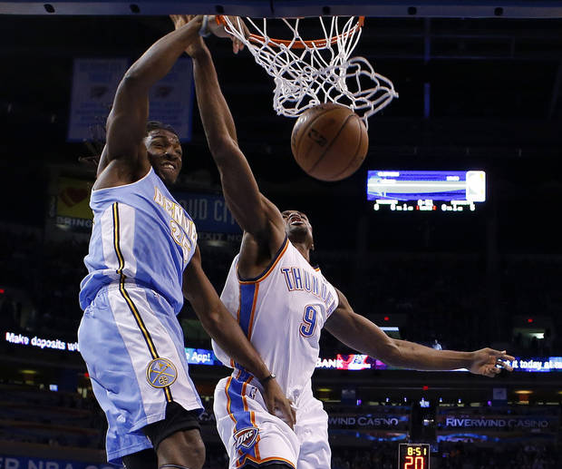 Denver's Kenneth Faried (35) dunks beside Oklahoma City's Serge Ibaka (9) during an NBA basketball game between the Oklahoma City Thunder and the Denver Nuggets at Chesapeake Energy Arena in Oklahoma City, Tuesday, March 19, 2013. Denver won 114-104. Photo by Bryan Terry, The Oklahoman