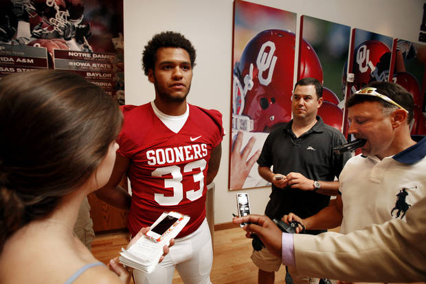 Trey Millard (33) speaks with the media during the Meet the Sooners event at the University of Oklahoma on Saturday, Aug. 4, 2012, in Norman, Okla.  Photo by Steve Sisney, The Oklahoman