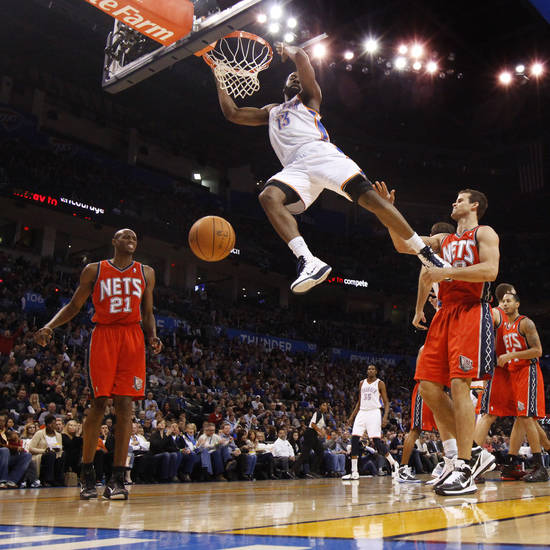 Oklahoma City's James Harden dunks the ball between New Jersey's Travis Outlaw, left, and Kris Humphries during the NBA basketball game between the Oklahoma City Thunder and the New Jersey Nets at the Oklahoma City Arena, Wednesday, Dec. 29, 2010.  Photo by Bryan Terry, The Oklahoman