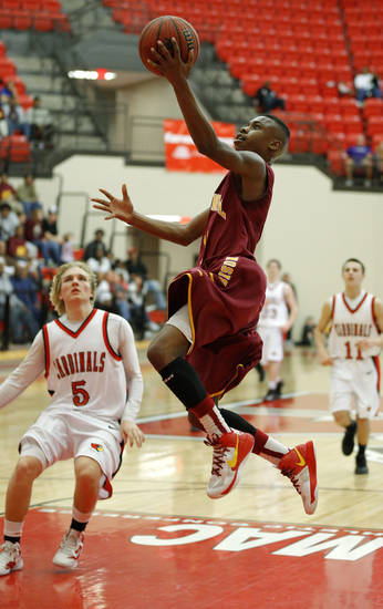 Centennial's Malcolm Mitchell goes to the basket past Dakota Brasher of Verdigris during a Class 3A boys state basketball tournament game between Centennial and Verdigris at Yukon High School in Yukon, Okla., Thursday, March 7, 2013. Photo by Bryan Terry, The Oklahoman
