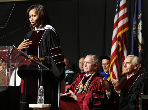 First lady Michelle Obama, left, delivers a commencement speech at Eastern Kentucky University in Richmond, Ky., Saturday, May 11, 2013, as Kentucky Gov. Steve Beshear, right, and university president Dr. Charles D. Whitlock. (AP Photo/James Crisp)