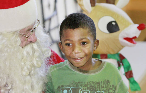 Josepher Powell, 4, sits on Santa's lap at the City Rescue Mission, Friday, December 23 , 2011. Santa Claus is J.D. Simpson and he has been playing Santa at the  City Rescue Mission since 1984. Photo by David McDaniel, The Oklahoman