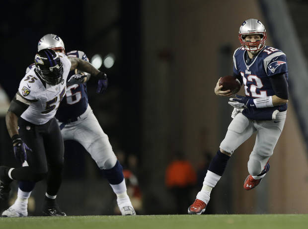 New England Patriots quarterback Tom Brady, right, runs with the ball while being chased by Baltimore Ravens linebacker Terrell Suggs (55) during the first half of the NFL football AFC Championship football game against the Baltimore Ravens in Foxborough, Mass., Sunday, Jan. 20, 2013. (AP Photo/Matt Slocum)