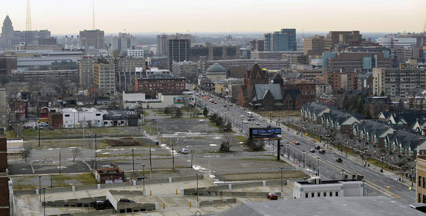 "This photo shows an area of vacant lots at Woodward and Temple in Detroit, on Tuesday, Dec. 4, 2012,  where a proposed light rail stop would be located. Detroit Red Wings owner Mike Ilitch is planning a $650 million multiuse development in downtown Detroit that includes a new home for his hockey team, it was announced Tuesday. Ilitch said he's proposing a ""substantial investment in the development of a new residential, retail, office and entertainment district in downtown Detroit."" (AP Photo/Detroit News, John T. Greilick)  DETROIT FREE PRESS OUT; HUFFINGTON POST OUT"