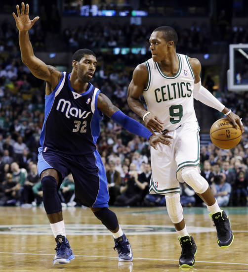 Boston Celtics guard Rajon Rondo (9) handles the ball against Dallas Mavericks shooting guard O.J. Mayo (32) during the second quarter of an NBA basketball game in Boston, Wednesday, Dec. 12, 2012. (AP Photo/Elise Amendola)
