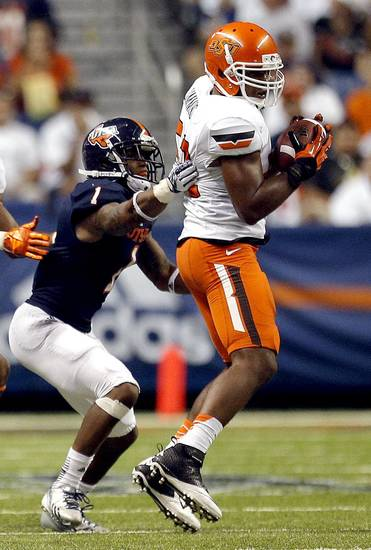 Oklahoma State's Ryan Simmons (52) intercepts a pass intended for UTSA's Kam Jones during a college football game between the University of Texas at San Antonio Roadrunners (UTSA) and the Oklahoma State University Cowboys (OSU) at the Alamodome in San Antonio, Saturday, Sept. 7, 2013.  Photo by Sarah Phipps, The Oklahoman