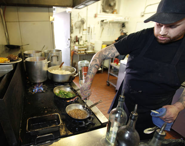 Josh Wion gets ready for the lunch crowd at Picasso Cafe in Oklahoma City. Photo by Paul Hellstern, The Oklahoman <strong>PAUL HELLSTERN - Oklahoman</strong>