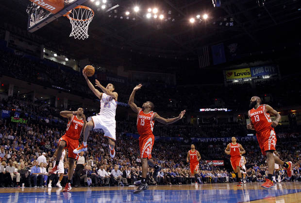 Oklahoma City 's Kevin Martin (23) drives past Houston's Terrence Jones (6) and Toney Douglas (15) during the NBA basketball game between the Houston Rockets and the Oklahoma City Thunder at the Chesapeake Energy Arena on Wednesday, Nov. 28, 2012, in Oklahoma City, Okla.   Photo by Chris Landsberger, The Oklahoman