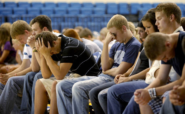Students and friends of Kyle Lewis react inside the Bethel High School gymnasium during a memorial for Kyle Lewis in Shawnee, Okla., Wednesday, July 28, 2010. Lewis was a Bethel High School student that graduated in May and died in a car wreck on Monday.  Photo by Bryan Terry, The Oklahoman