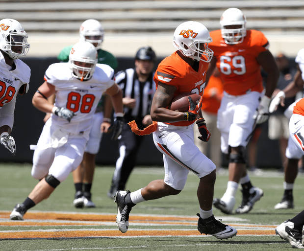 Oklahoma State's Tracy Moore runs after a catch during OSU's spring football game at Boone Pickens Stadium in Stillwater, Okla., Sat., April 20, 2013. Photo by Bryan Terry, The Oklahoman