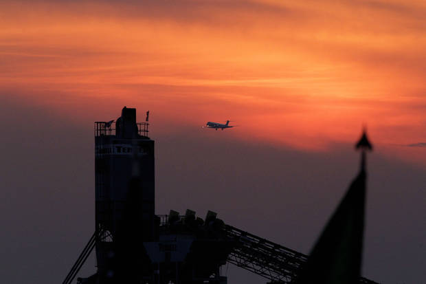 A plane takes off from Chicago O'Hare International Airport in between the arrival of world leaders attending the NATO Summit, on Saturday, May 19, 2012, in Chicago. Security has been high throughout the city in preparation for the NATO summit, where delegations from about 60 countries will discuss the war in Afghanistan and European missile defense. (AP Photo/Seth Perlman)
