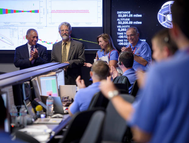 "In this photo released by NASA, White House Science and Technology Advisor John Holdren, second from left, stops by the Mars Science Laboratory (MSL) Mission Support Area to meet the landing team and to say ""Go Curiosity"" as NASA Administrator Charles Bolden, left, NASA Deputy Administrator Lori Garver, and Jet Propulsion Laboratory Director Charles Elachi, far right, look on, Sunday, Aug. 5, 2012 at NASA's Jet Propulsion Labratory in Pasadena, Calif. The MSL Rover named Curiosity was designed to assess whether Mars ever had an environment able to support small life forms called microbes. Curiosity is due to land on Mars at 10:31 p.m. PDT on Sunday night. (AP Photo/Bill Ingalls, NASA)"