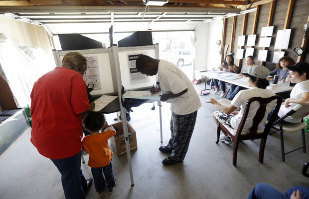FILE - This Nov. 6, 2012 file photo shows voters in the Weston Ranch area of Stockton, Calif. It's not just the economy. It's the demographics _ the changing face of America. The 2012 elections drove home trends that have been embedded in the fine print of birth and death rates, immigration statistics and census charts for years. America is rapidly getting more diverse. And, more gradually, so is its electorate. Non-whites made up 28 percent of the electorate this year, up from 21 percent in 2000, and much of that growth is coming from Hispanics. (AP Photo/Marcio Jose Sanchez, File)
