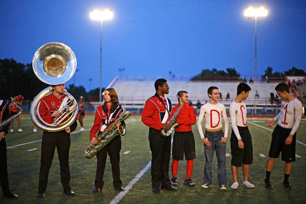 Del City students and band members form a line on the field before before a high school football game against Ardmore in Del City, Okla., Friday, September 28, 2012. Photo by Bryan Terry, The Oklahoman