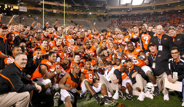 The OSU team poses for a photo after the Insight Bowl college football game between Oklahoma State University (OSU) and the Indiana University Hoosiers (IU) at Sun Devil Stadium on Monday, Dec. 31, 2007, in Tempe, Ariz. 