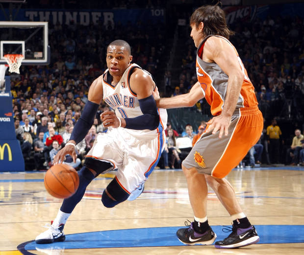 Oklahoma City's Russell Westbrook (0) drives to the basket as Phoenix's Steve Nash (13) defends during the NBA game between the Oklahoma City Thunder and the Phoenix Suns, Sunday, March 6, 2011, the Oklahoma City Arena. Photo by Sarah Phipps, The Oklahoman.