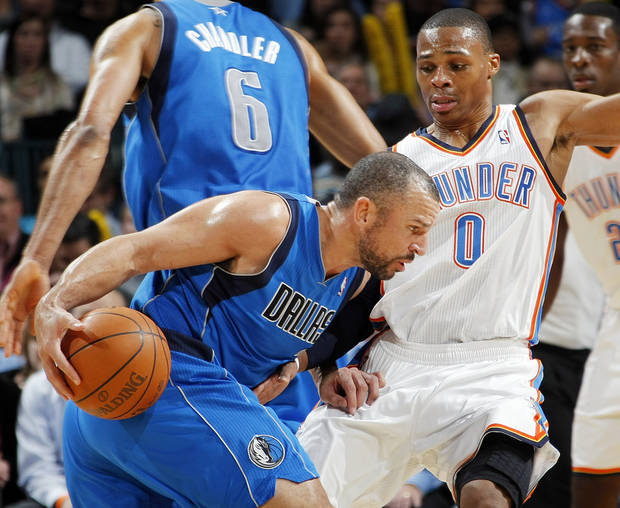 Jason Kidd (2) of Dallas drives the ball as Russell Westbrook (0) of Oklahoma City defends during the NBA basketball game between the Dallas Mavericks and the Oklahoma City Thunder at the Oklahoma City Arena in Oklahoma City, Monday, Dec. 27, 2010. Dallas won, 103-93. Photo by Nate Billings, The Oklahoman