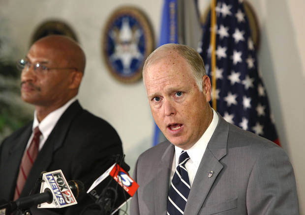 U.S. Attorney Sanford C. Coats, right, speaks to reporters Monday about a gambling indictment, while FBI Special Agent Jim Finch listens. Photo by Jim Beckel, The Oklahoman  <strong>Jim Beckel - THE OKLAHOMAN</strong>