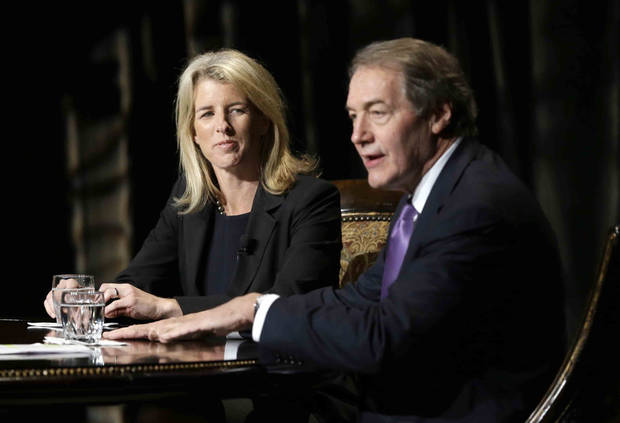 Journalist Charlie Rose, right, makes opening comments as Rory Kennedy, left, looks on during a Rose interview in front of a full audience that included her brother Robert F. Kennedy Jr., at the AT&T Performing Arts Center Friday, Jan. 11, 2013, in Dallas, Texas.  The Kennedys are in Dallas as a year of observances begins for the 50th anniversary of President John F. Kennedy's assassination. (AP Photo/Tony Gutierrez)
