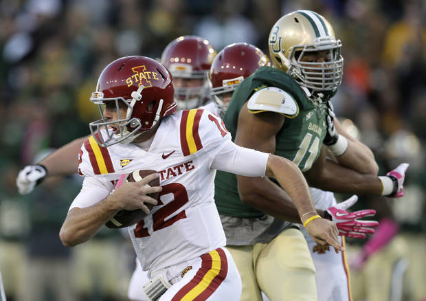 Iowa State quarterback Sam B. Richardson (12) scrambles out of the pocket under pressure from Baylor defensive end Terrance Lloyd, right, in the first half of an NCAA college football game, Saturday, Oct. 19, 2013, in Waco, Texas. (AP Photo/Tony Gutierrez)