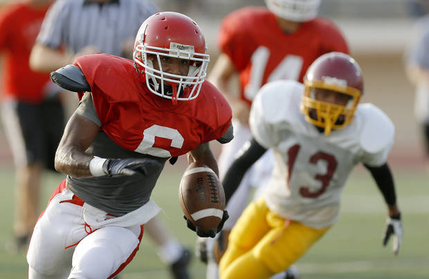 Lawton's Dajuan Wojciechowski runs the ball during a football scrimmage against Putnam City North at Putnam City High School in Warr Acres, Okla., Thursday, August 16, 2012. Photo by Bryan Terry, The Oklahoman