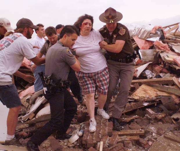 May 3, 1999, Oklahoma City Tornado:  Tornado damage, victim: Rescue workers bring Renee Faulkinberry out from under the rubble of her home in the Country Place Estates housing addition SW of 134th and S. Penn. About a dozen volunteers worked for nearly a half hour to free Renee.  Staff Photo by Paul Hellstern