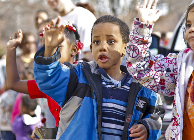 Christopher Hendricks Jr. waves to floats as they pass by during Martin Luther King Jr. Day parade through downtown Oklahoma City on Monday, Jan. 16, 2012, in Oklahoma City, Okla. Photo by Chris Landsberger, The Oklahoman