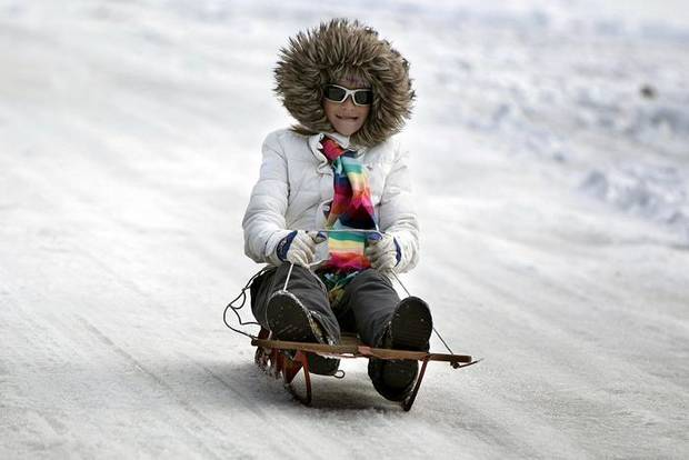 Claire McCoy, 12, sleds on hill in the Trails neighborhood, Saturday, Dec. 26, 2009, in Edmond, Okla. Photo by Sarah Phipps, The Oklahoman