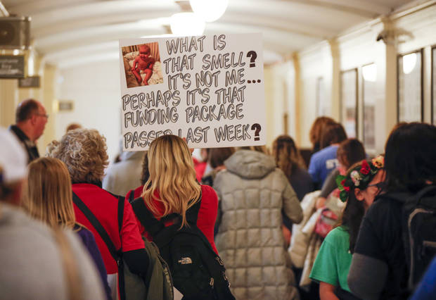Teachers and their supporters walk through the hall of the state senate during a rally and walkout by Oklahoma teachers at the state Capitol in Oklahoma City, Monday, April 2, 2018. Photo by Nate Billings, The Oklahoman
