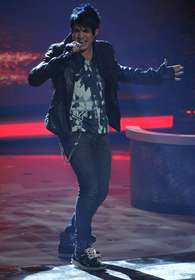 "In this photo made available Tuesday,  April 14, 2009 Adam Lambert performs on the singing competition series, ""American Idol,"" in Los Angeles. (AP Photo/Fox, Frank Micelotta) ** NO SALES **  ORG XMIT: NY135"