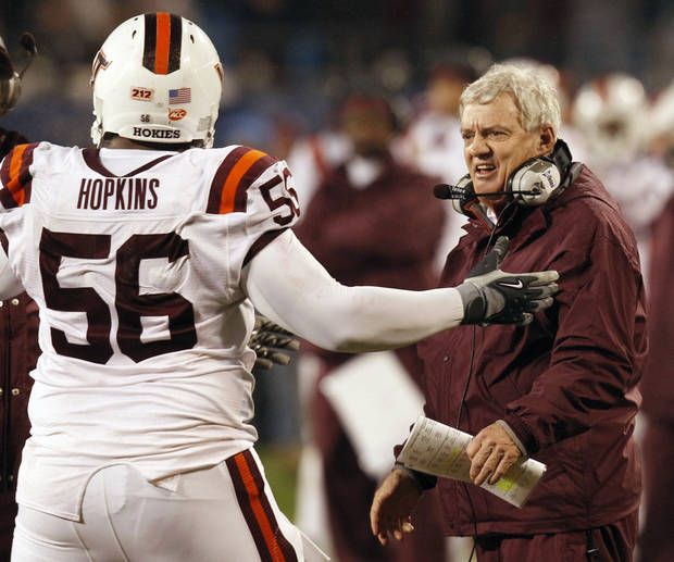 Virginia Tech head coach Frank Beamer, right, shouts to Antoine Hopkins (56) in the first half against Florida State in the Atlantic Coast Conference championship NCAA college football game in Charlotte, N.C., Saturday, Dec. 4, 2010. (AP Photo/Chuck Burton) ORG XMIT: NCCB110