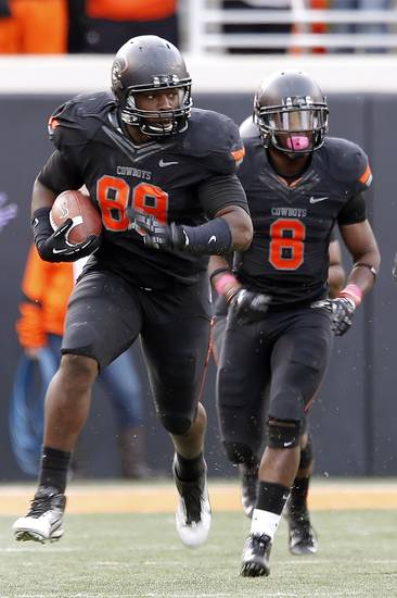 Oklahoma State's Nigel Nicholas (89) returns the ball after recovering a fumble during a college football game between Oklahoma State University (OSU) and Texas Christian University (TCU) at Boone Pickens Stadium in Stillwater, Okla., Saturday, Oct. 27, 2012. Photo by Sarah Phipps, The Oklahoman