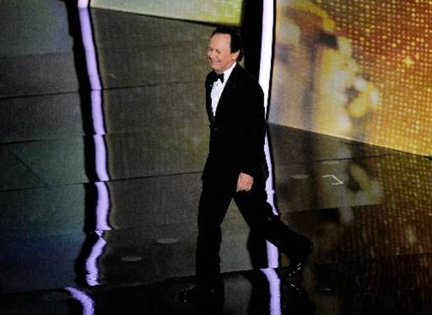 Former Oscar host Billy Crystal takes the stage.