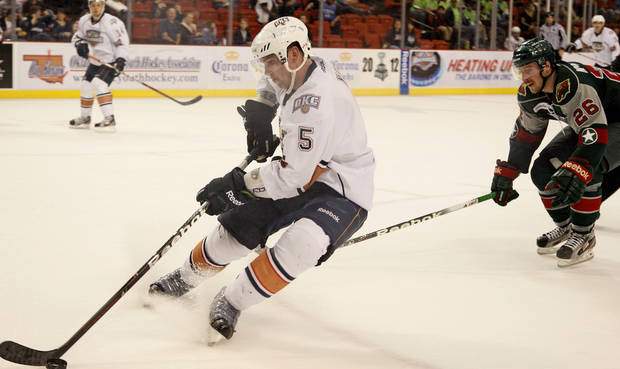 Dylan Yeo of the Oklahoma City Barons skates past David McIntyre of the Houston Aeros during a hockey game at the Cox Convention Center in Oklahoma City, Friday, April 13, 2012. Photo by Bryan Terry, The Oklahoman