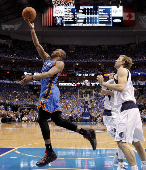 Oklahoma City's Russell Westbrook (0) goes past Dallas' Dirk Nowitzki (41) and Shawn Marion (0) during Game 3 of the first round in the NBA playoffs between the Oklahoma City Thunder and the Dallas Mavericks at American Airlines Center in Dallas, Thursday, May 3, 2012. Oklahoma City won 95-79. Photo by Bryan Terry, The Oklahoman