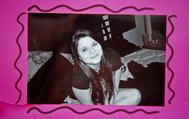 Photos of Carina Saunders brought by friends during a vigil on Tuesday afternoon for Carina Saunders, whose body was found in a duffel bag last week behind a Bethany Homeland last week. &lt;strong&gt;CHRIS LANDSBERGER - CHRIS LANDSBERGER&lt;/strong&gt;