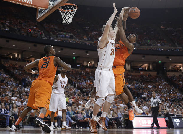 Oklahoma State's Le'Bryan Nash (2) is defended by Texas' Connor Lammert (21) as he tries to shoot during the second half of an NCAA college basketball game, Saturday, Feb. 9, 2013, in Austin, Texas. Oklahoma State won 72-59. (AP Photo/Eric Gay) ORG XMIT: TXEG112