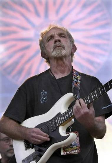 "In this June 5, 2004 file photo, singer-songwriter J.J. Cale plays during the Eric Clapton Crossroads Guitar Festival in Dallas, Texas. Cale, whose best-known songs became hits for Eric Clapton with ""After Midnight"" and Lynyrd Skynyrd with ""Call Me the Breeze,"" has died. He was 74. (AP)"