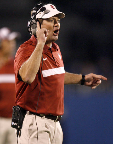 Oklahoma's Bob Stoops shouts to his team during the college football game between the University of Oklahoma Sooners (OU) and the University of Kansas Jayhawks (KU) at Memorial Stadium in Lawrence, Kansas, Saturday, Oct. 15, 2011. Photo by Bryan Terry, The Oklahoman