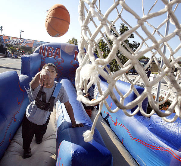 Micah Kee, 13, of Woodward, Okla. enjoys the outdoor fun during the opening night NBA basketball game between the Oklahoma City Thunder and the Milwaukee Bucks on Wednesday, Oct. 29, 2008, at the Ford Center in Oklahoma City, Okla.
