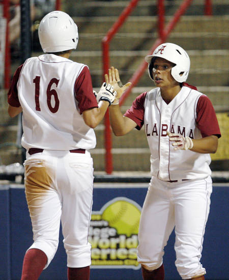 Alabama's Kellie Eubanks (16) is congratulated by Brittany Rogers (8) after Eubanks scored in the fifth inning during the softball game in the Women's College World Series between Louisiana-Lafayette and Alabama at ASA Hall of Fame Stadium in Oklahoma City, Saturday, May 31, 2008. BY NATE BILLINGS, THE OKLAHOMAN