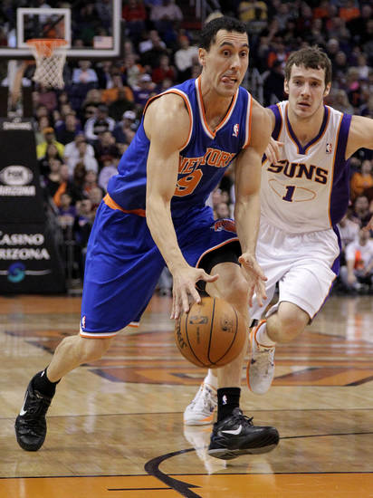 New York Knicks' Pablo Prigioni (9), of Argentina, drives against Phoenix Suns' Goran Dragic (1), of Slovenia, during the first half of an NBA basketball game on Wednesday, Dec. 26, 2012, in Phoenix. (AP Photo/Matt York)