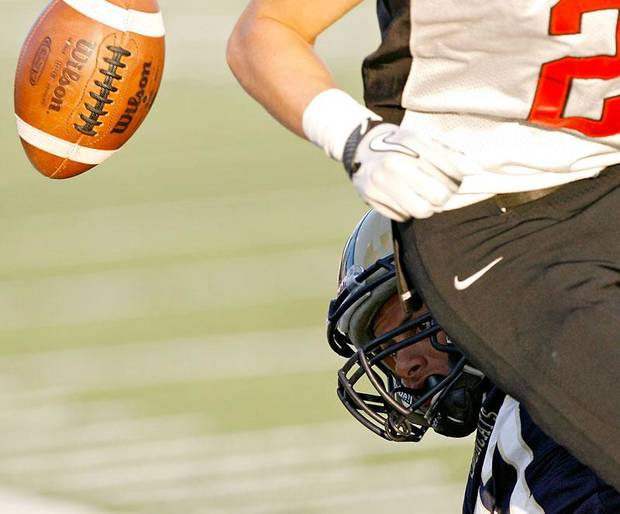 Southmoore's Spencer Martin keeps his eye on a loose ball as he tackles Westmoore's Austin Bowling out of bounds during their high school football game at Moore Stadium in Moore, Oklahoma on Friday, September 9, 2011. Photo by John Clanton, The Oklahoman