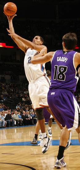 Oklahoma City's Thabo Sefolosha (2) shoots past Omri Casspi (18) of Sacramento during the NBA preseason game between the Sacramento Kings and the Oklahoma City Thunder at the Ford Center in Oklahoma City, Thursday, Oct. 22, 2009. Photo by Nate Billings, The Oklahoman
