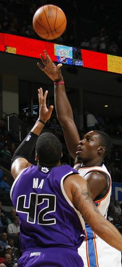 Jeff Green (22) of Oklahoma City shoots over Sean May (42) of Sacramento during the NBA preseason game between the Sacramento Kings and the Oklahoma City Thunder at the Ford Center in Oklahoma City, Thursday, Oct. 22, 2009. Sacramento won, 104-89. Photo by Nate Billings, The Oklahoman