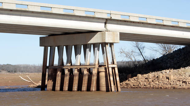 Piers on the Alameda Street bridges over Lake Thunderbird are exposed by low water levels in December 2012. Photo by Steve Sisney, The Oklahoman Archives