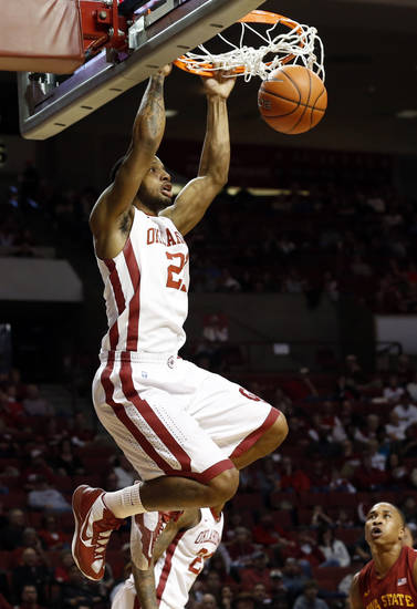 Oklahoma's Cameron Clark (21) dunks as the University of Oklahoma Sooners (OU) men play the Iowa State Cyclones in NCAA, college basketball at Lloyd Noble Center on Saturday, March 2, 2013  in Norman, Okla. Photo by Steve Sisney, The Oklahoman