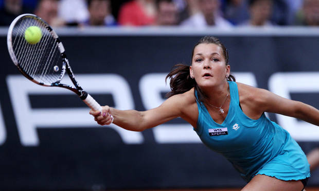 Poland's Agnieszka Radwanska hits a forehand against China's Li Na during their quarterfinal match at the Porsche tennis Grand Prix in Stuttgart, Germany, Friday, April 27, 2012. (AP Photo/Michael Probst) ORG XMIT: PSTU102