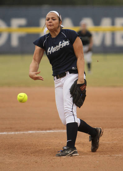Edmond North's Jordan Dixon (11) pitches during a 6A state softball semifinals game between Edmond North and Yukon at ASA Hall of Fame Stadium in Oklahoma City, Okla., Friday, Oct. 12, 2012.  Photo by Garett Fisbeck, The Oklahoman