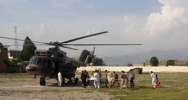 A wounded Pakistani girl, Malala Yousufzai, is moved to a helicopter to be taken to Peshawar for treatment in Mingora, Swat Valley, Pakistan, Tuesday, Oct. 9, 2012. A Taliban gunman walked up to a bus taking children home from school in Pakistan�s volatile Swat Valley Tuesday and shot and wounded a 14-year-old activist known for championing the education of girls and publicizing atrocities committed by the Taliban, officials said.(AP Photo/Sherin Zada)